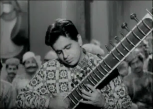 Dileep Kumar playing a sitar in 'Kohinoor'